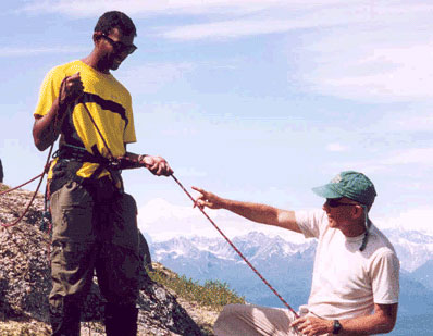 tom and Ajay on mountain using guiding ropes